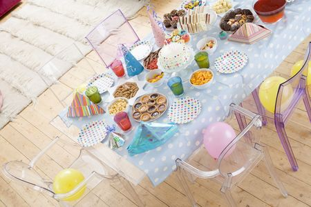 childs birthday party: Birthday party table setting with food Stock Photo