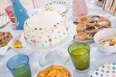 childrens food: Birthday party table setting with food Stock Photo