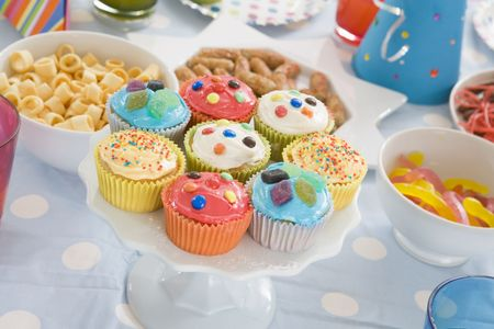 birthday food: Birthday party table setting with food Stock Photo