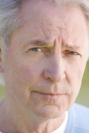 Head shot of man thinking photo