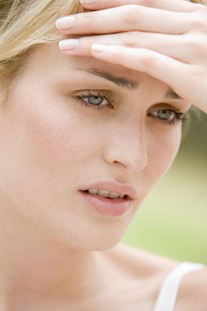 bad temper: Head shot of woman scowling