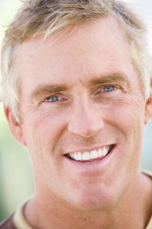 early 40s: Head shot of man smiling