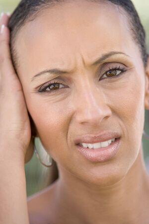 Head shot of woman scowling photo