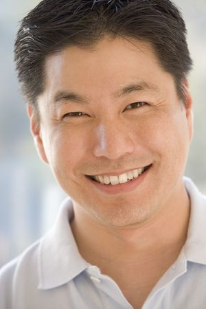 asian man face: Head shot of man smiling