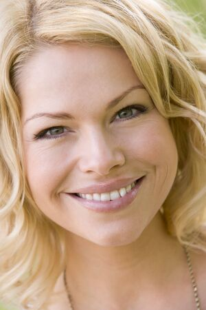 30s: Head shot of woman smiling Stock Photo