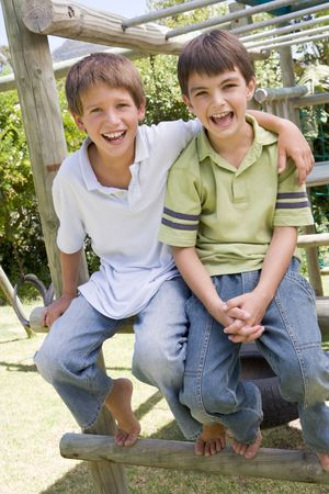 Two young male friends at a playground smiling Stock Photo - 3488233