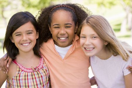 Three young girl friends outdoors smiling Stock Photo - 3488029