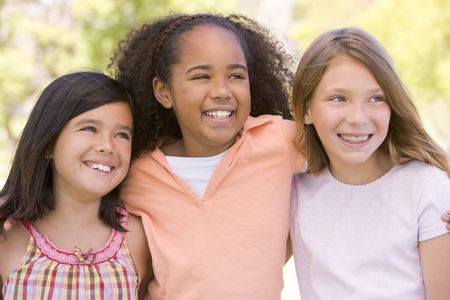 Three young girl friends outdoors smiling Stock Photo - 3487477