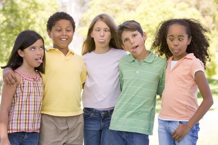 Five young friends standing outdoors making funny faces Stock Photo - 3488079
