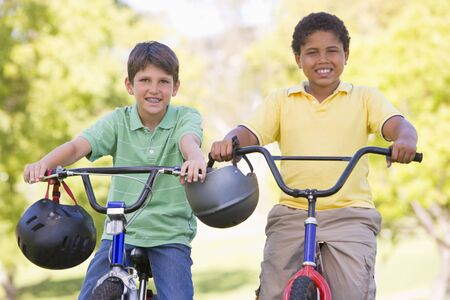Two young boys on bicycles outdoors smiling Stock Photo - 3486981