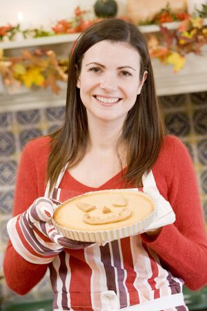 Woman in kitchen making Halloween treats and smiling Stock Photo - 3487914