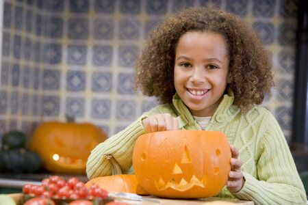 Young girl on Halloween with jack o lantern smiling photo
