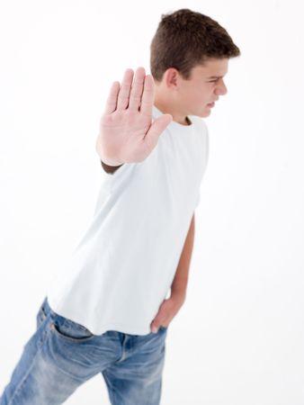 Teenage boy standing with hand up photo