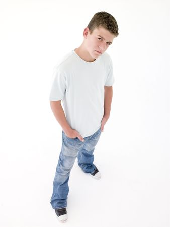 confrontational: Teenage boy standing with hands in pockets Stock Photo