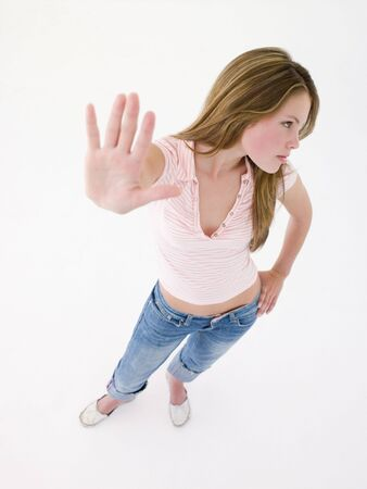 confrontational: Teenage girl with hand up Stock Photo