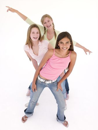 tween boy: Three girl friends in a row smiling Stock Photo