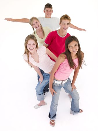 Five friends in a row smiling Stock Photo - 3488283