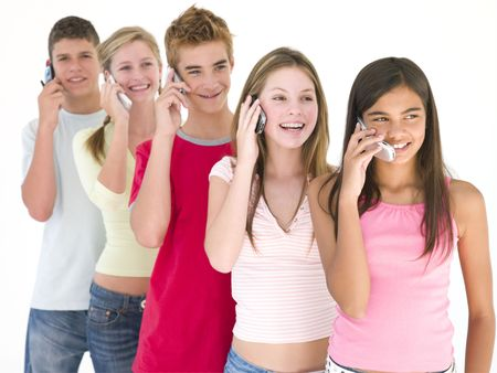 Row of five friends on cellular phones smiling photo