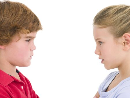 girl fighting: Brother and sister staring at each other