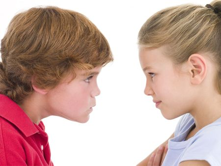 brother sister fight: Brother and sister staring at each other