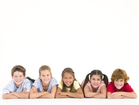 Row of five friends lying down smiling photo