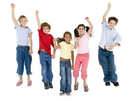 children jumping: Five friends jumping and smiling