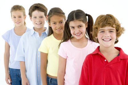 standing in line: Row of five young friends smiling Stock Photo
