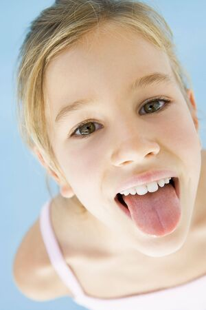 girl tongue: Young girl sticking her tongue out