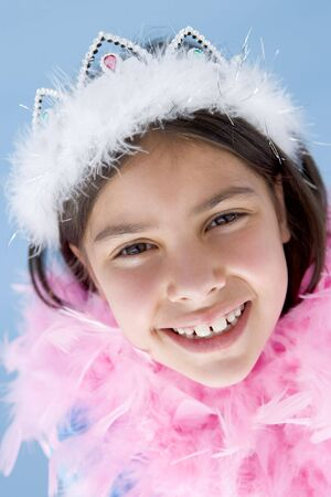 feather boa: Young girl wearing crown and feather boa smiling