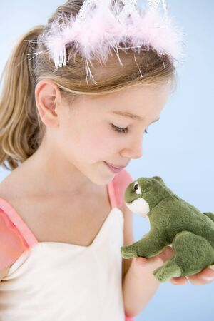 Young girl in princess costume kissing plush frog Stock Photo - 3603079
