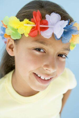 hula girl: Young girl wearing garland on head smiling