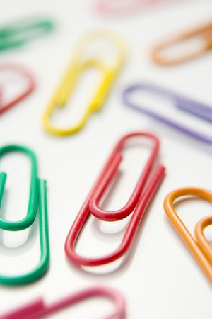 Studio Shot Of Multi Colored Paperclips photo