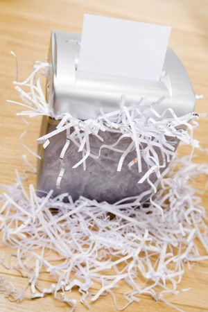 shredder: An Overflowing Paper Shredder