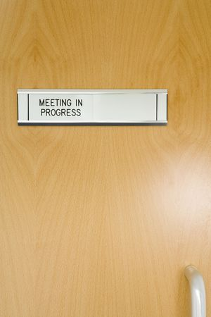 one to one meeting: A Closed Office Door, With Meeting In Progress Sign Stock Photo