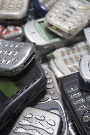 old cell phone: Pile Of Used Mobile Phones Stock Photo