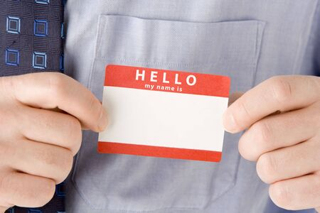 breast pocket: Close Up Of Businessman Attaching Name Tag