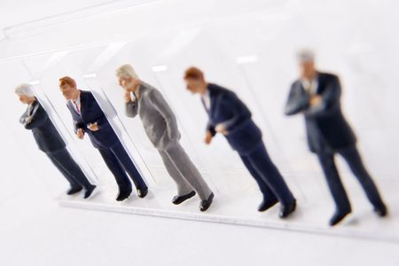 human likeness: Line Of Businessmen Figurines Stock Photo