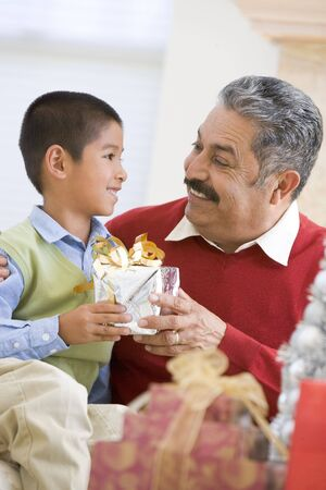 Boy Surprising Father With Christmas Present photo