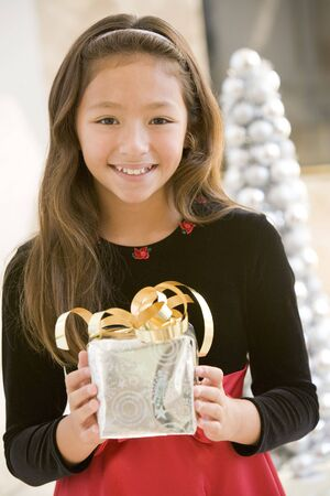 preadolescent: Young Girl Smiling,Holding Christmas Gift