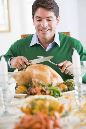 carving: Man Excitedly Carving A Turkey