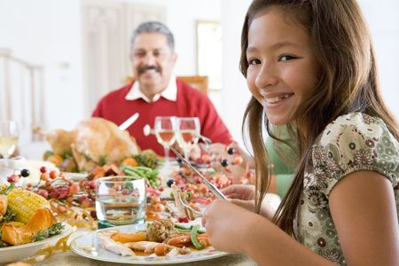 Grandfather And Granddaughter Sitting Down For Christmas Dinner photo