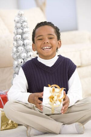 Portrait Of Boy With Christmas Present photo