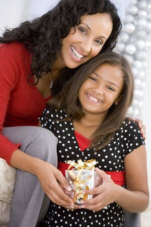 Mother Giving Daughter Her Christmas Present Stock Photo - 3724966