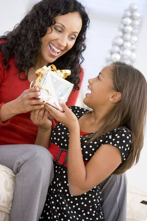 Mother Giving Daughter Her Christmas Present Stock Photo - 3724942