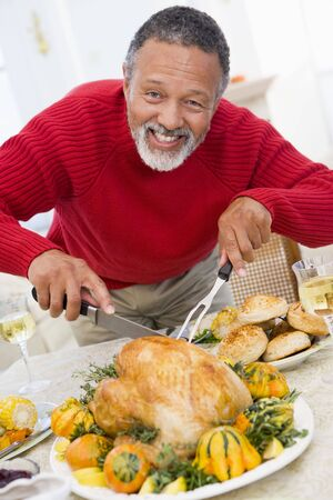 Man Carving Roast Chicken photo