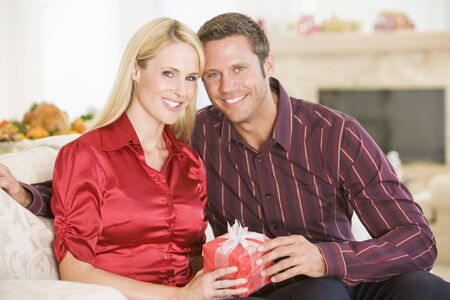 Couple Sharing Christmas Present Stock Photo - 3726422