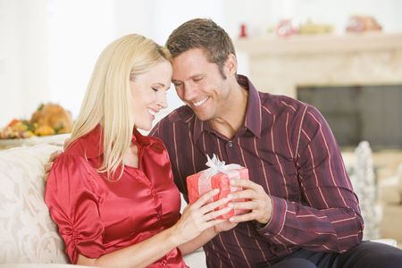 Couple Sharing Christmas Present Stock Photo - 3726476