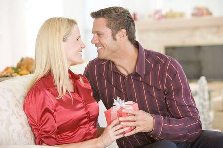 Couple Sharing Christmas Present photo