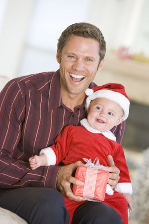 Father With Son In Santa Outfit photo