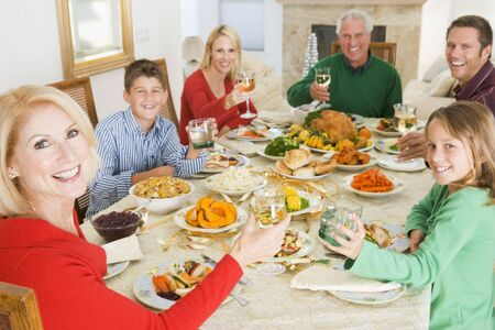 Family All Together At Christmas Dinner photo